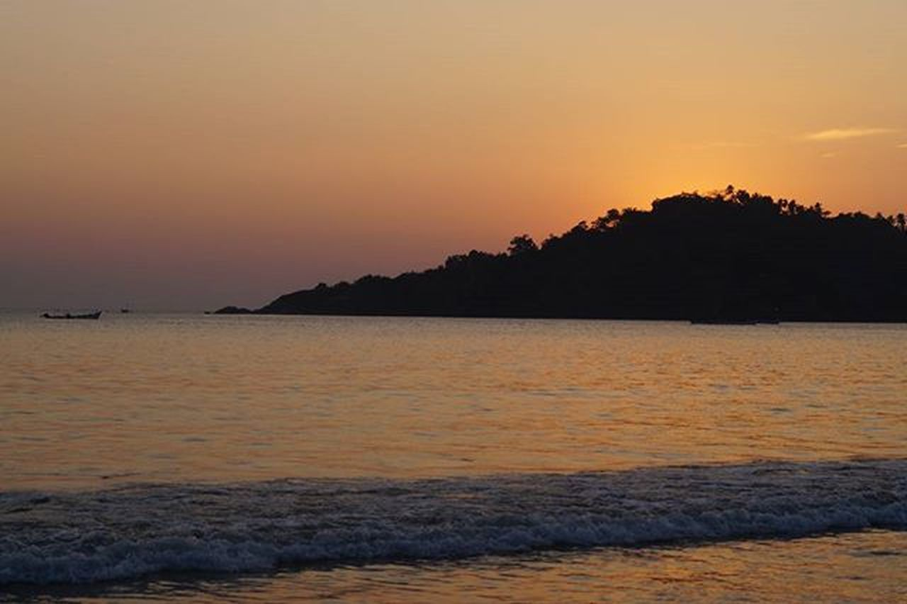 sea, sunset, beach, scenics, beauty in nature, horizon over water, nature, tranquil scene, tranquility, water, travel destinations, vacations, outdoors, sky, silhouette, no people, tourism, landscape, summer, travel, wave, horizon, tree, clear sky, view into land, day