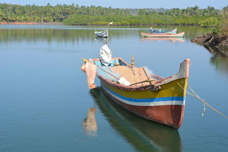 Boat moored in lake