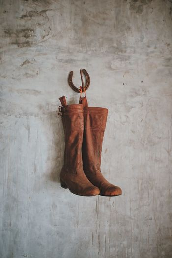Shoes hanging on wall