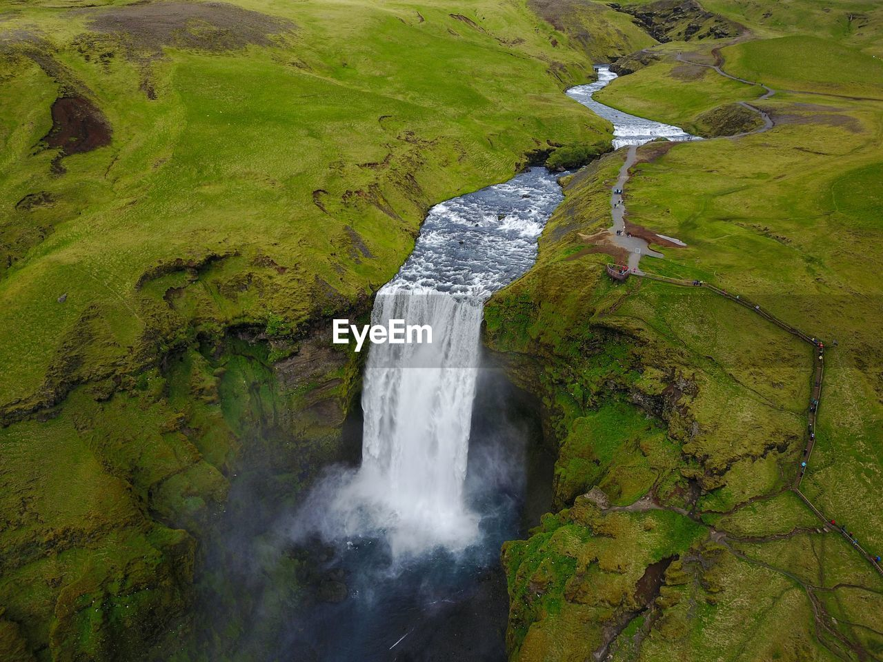 High Angle View Of Waterfall Amidst Landscape