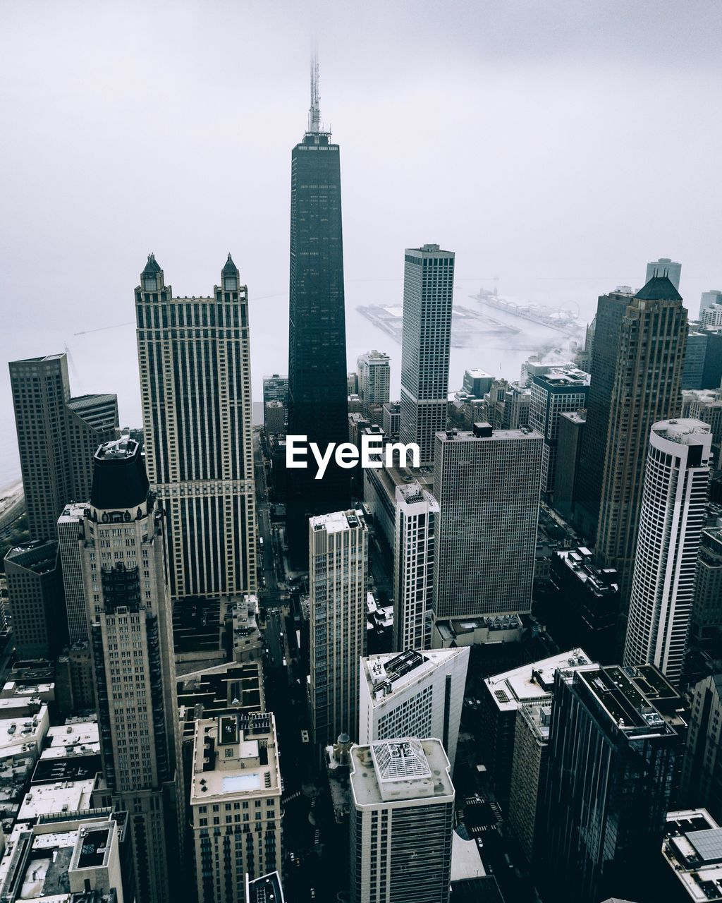 Aerial view of buildings in city during foggy weather