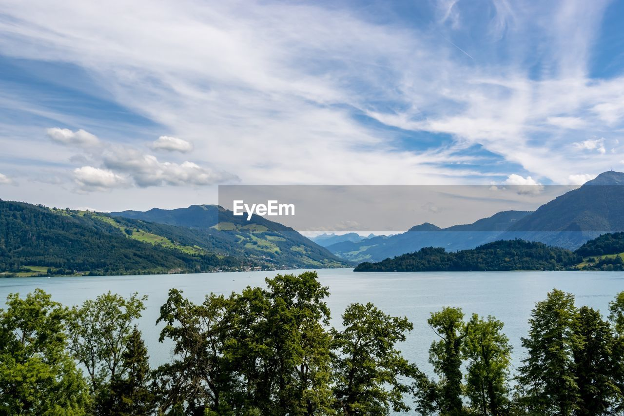 scenics - nature, water, beauty in nature, mountain, sky, tree, tranquil scene, cloud - sky, tranquility, plant, non-urban scene, lake, nature, idyllic, mountain range, day, no people, growth, outdoors, range