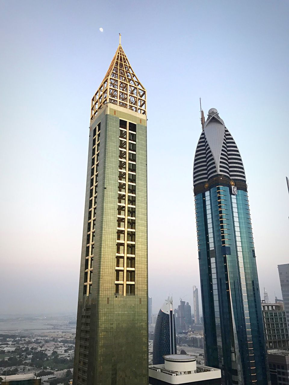 building exterior, built structure, architecture, building, office building exterior, sky, city, skyscraper, tall - high, tower, modern, travel destinations, office, clear sky, no people, nature, low angle view, cityscape, spire, financial district, outdoors, luxury