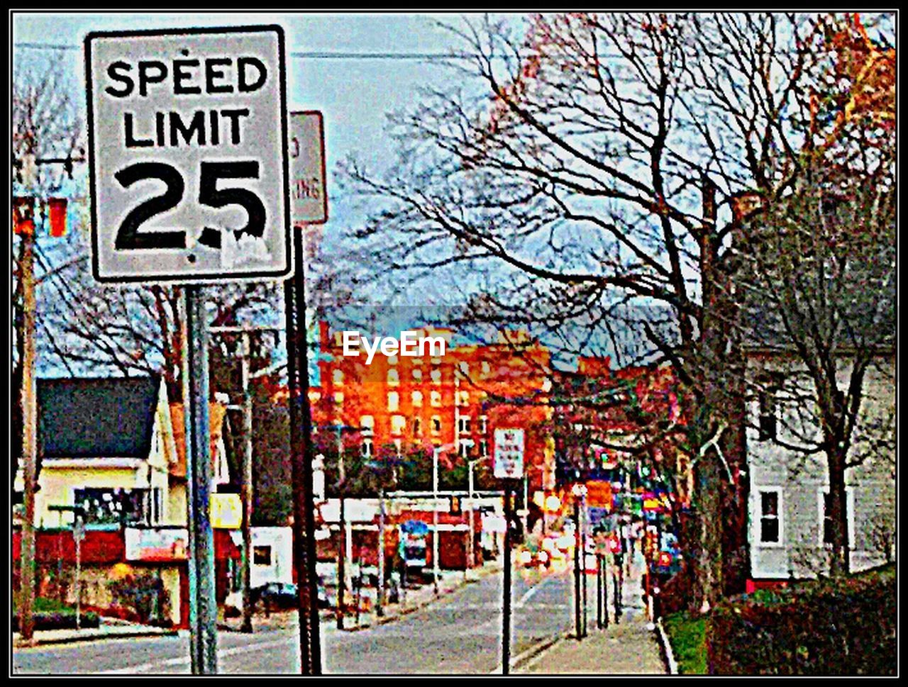 text, communication, tree, no people, outdoors, bare tree, day, architecture, sky, road sign, building exterior, city, nature