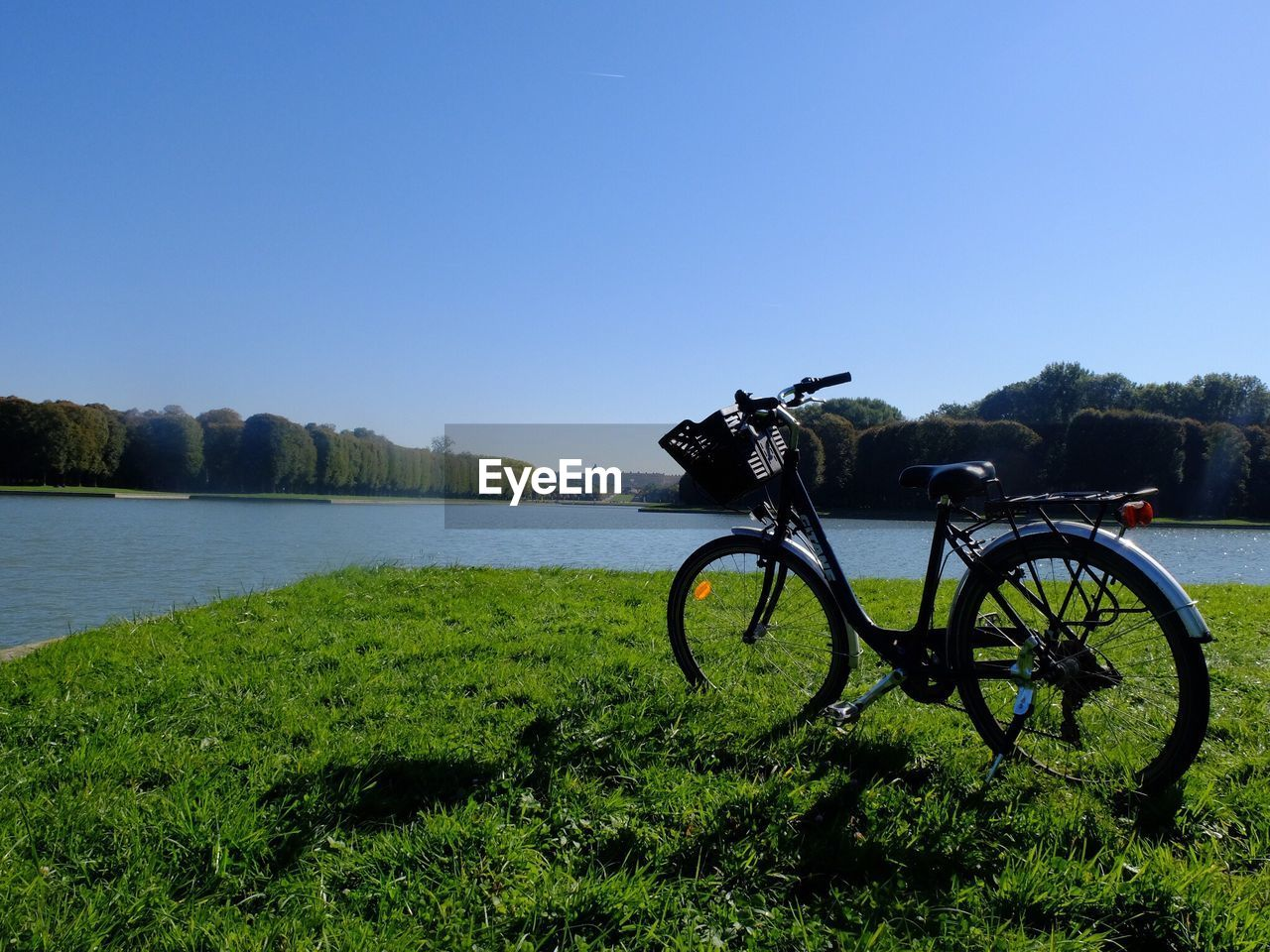 BICYCLE ON FIELD AGAINST CLEAR SKY