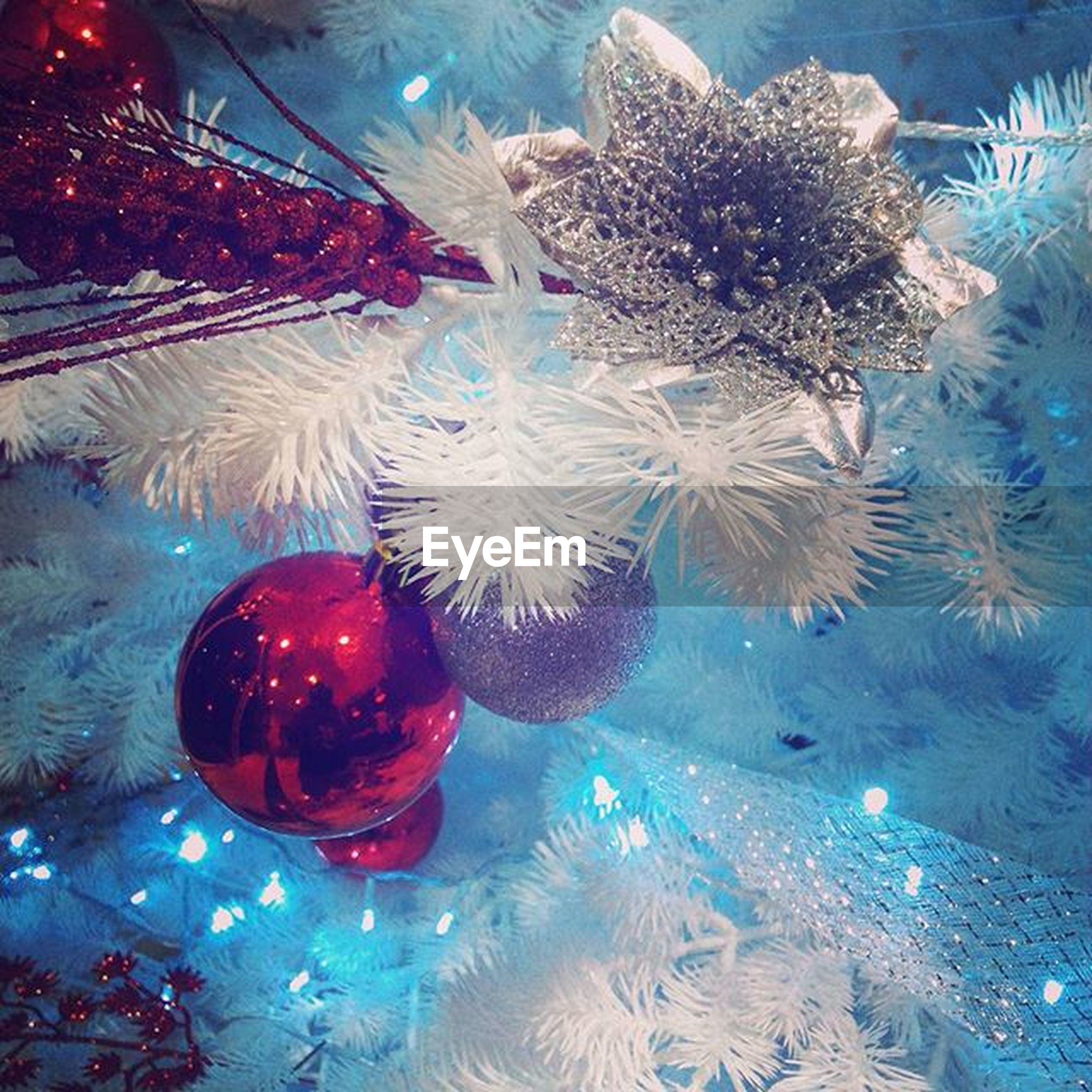 indoors, transparent, glass - material, water, reflection, celebration, christmas, cold temperature, no people, blue, table, swimming pool, decoration, high angle view, close-up, still life, food and drink, christmas decoration, glass, illuminated
