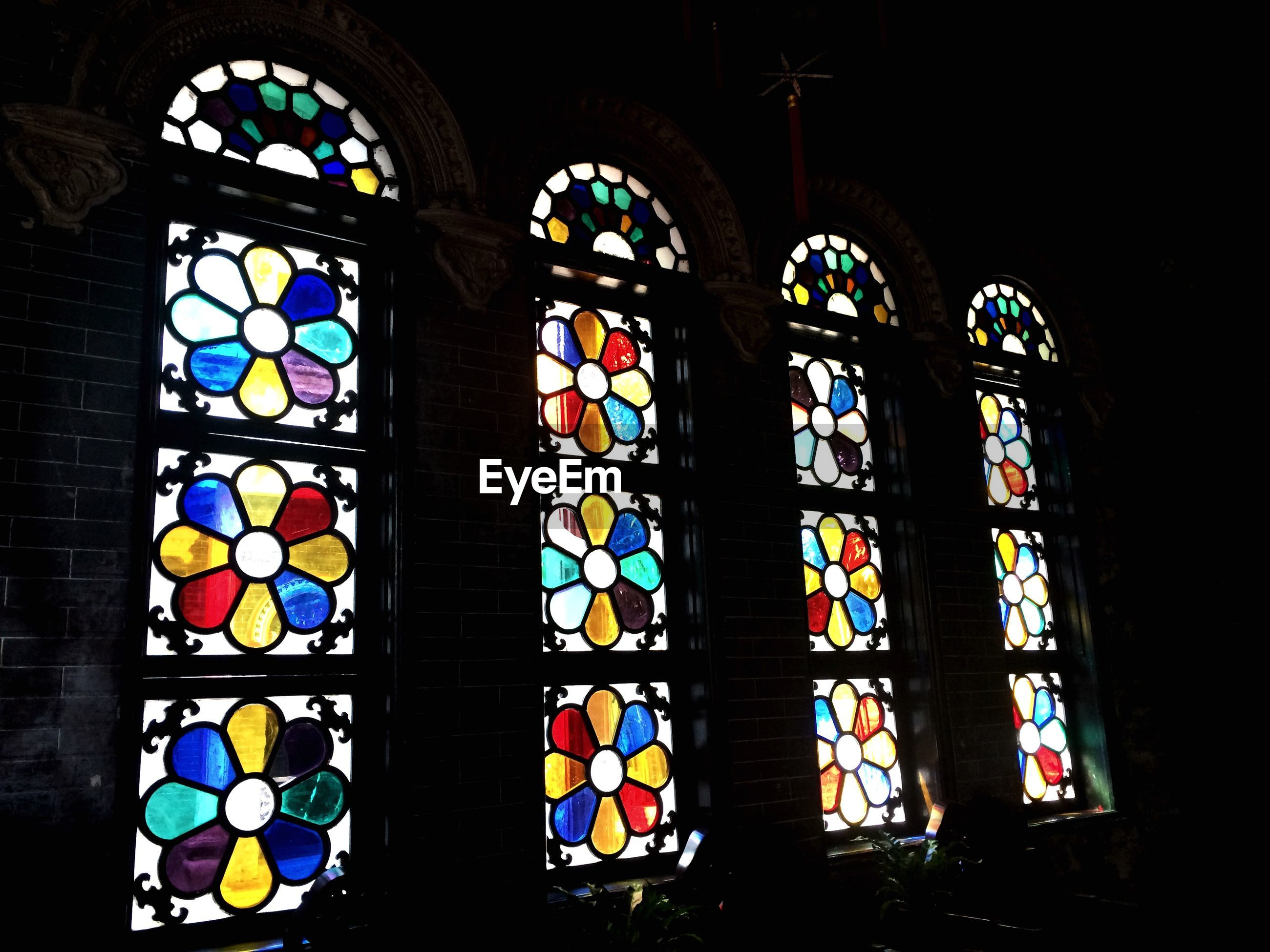indoors, stained glass, window, religion, arch, place of worship, multi colored, spirituality, church, built structure, architecture, art, art and craft, design, hanging, ornate, creativity, decoration