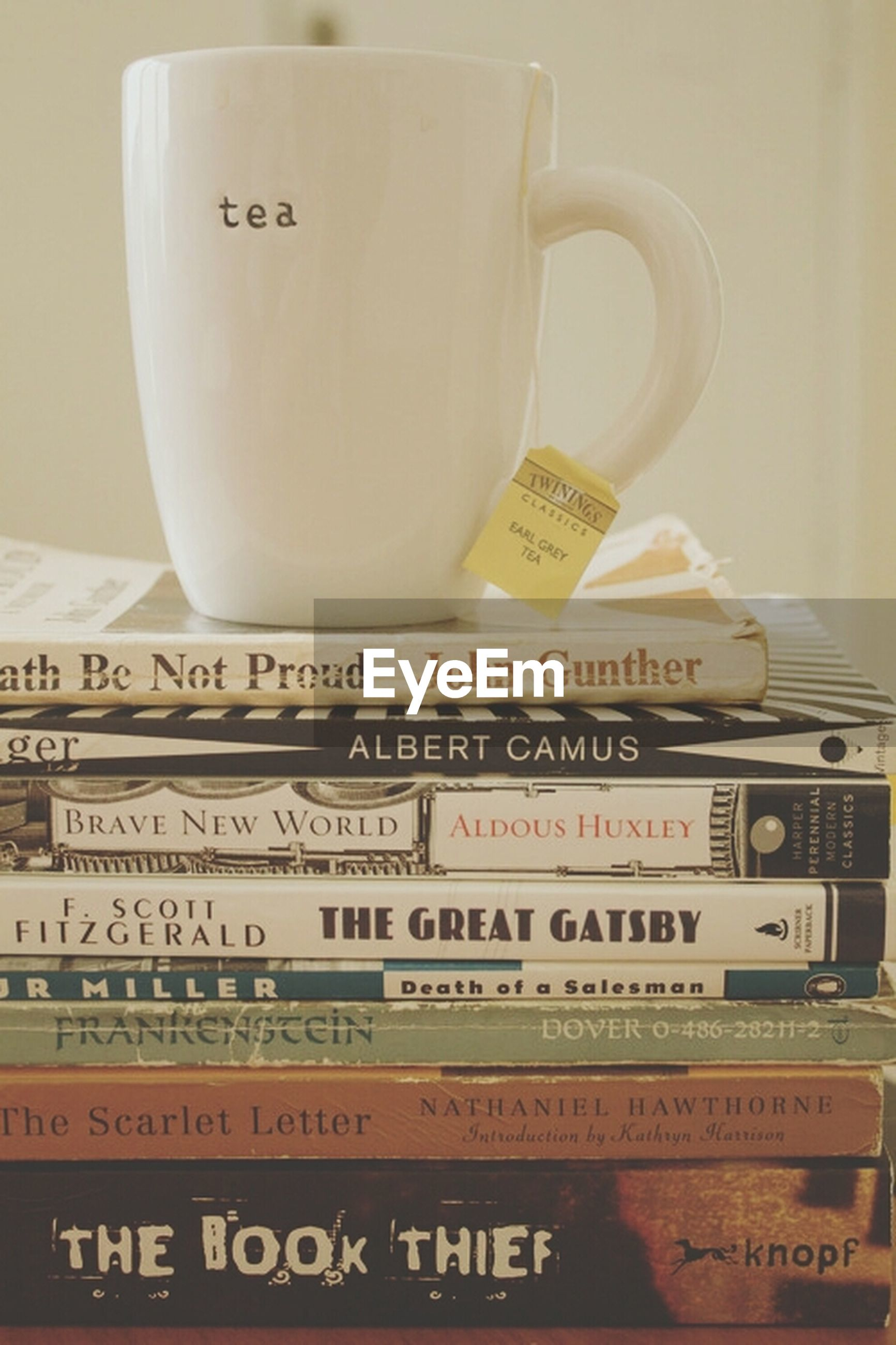 indoors, text, communication, western script, still life, close-up, table, book, non-western script, education, no people, number, paper, white color, technology, coffee cup, message, food and drink, capital letter, open