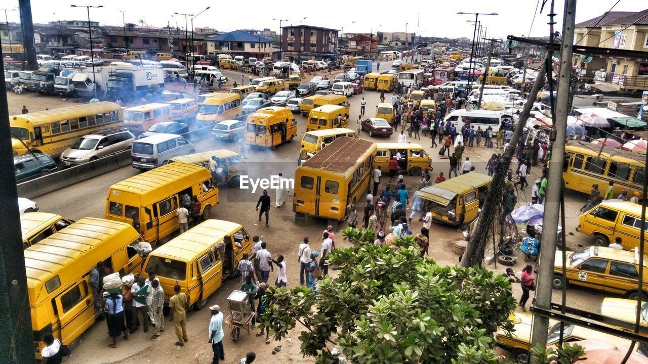 High angle view of people and buses at iyana ipaja bus stop