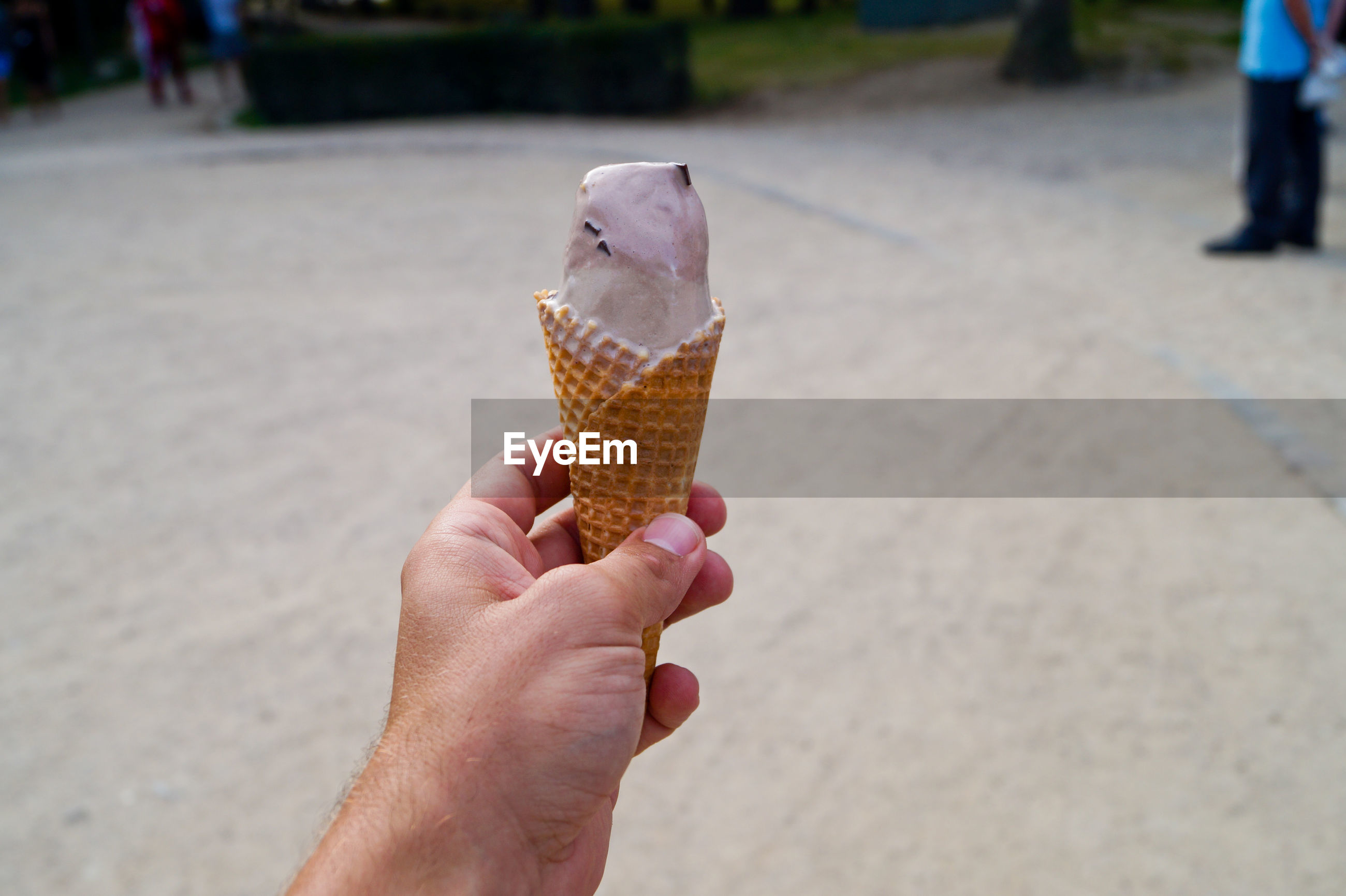 Cropped hand of man holding ice cream cone