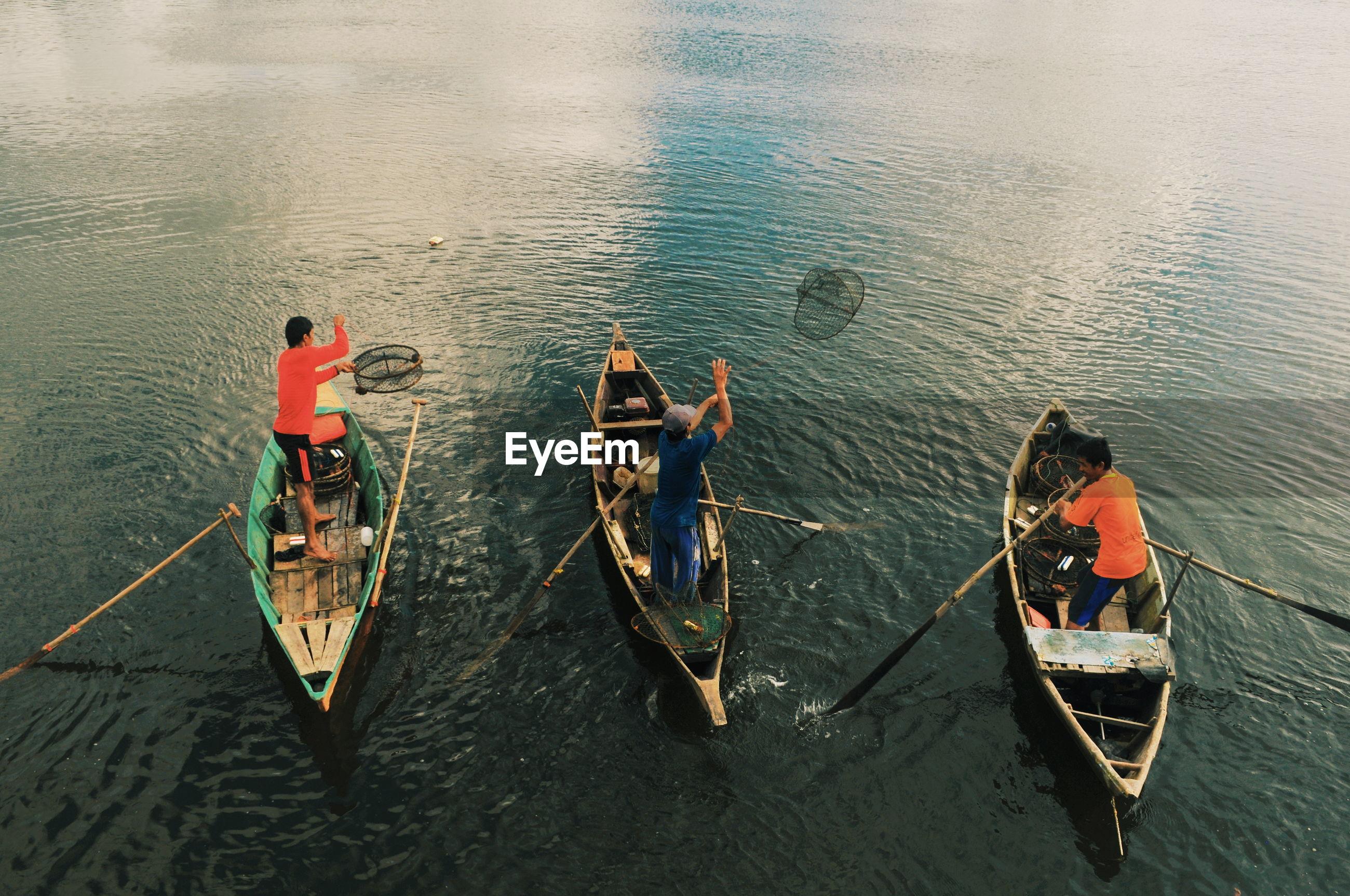 High angle view of men boating on lake