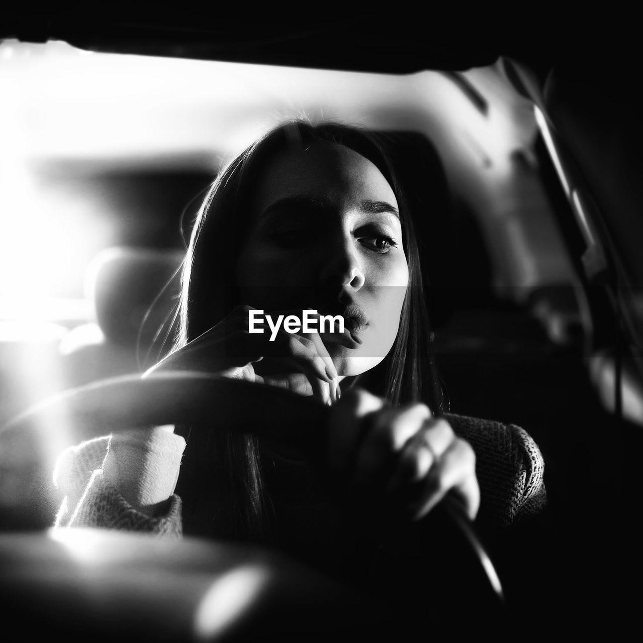 Beautiful Woman Sitting In Car At Night