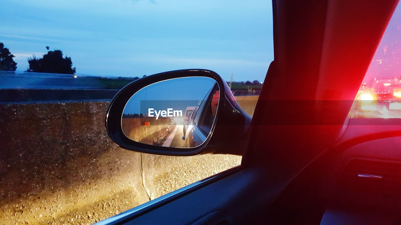 side-view mirror, transportation, mode of transport, car, land vehicle, window, reflection, sky, day, vehicle mirror, no people, outdoors, nature, close-up