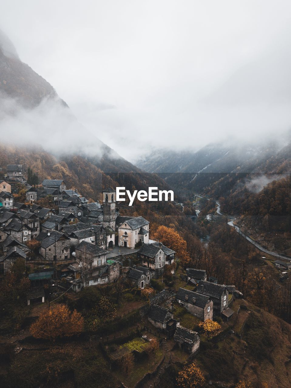High Angle View Of Town On Mountain During Foggy Weather