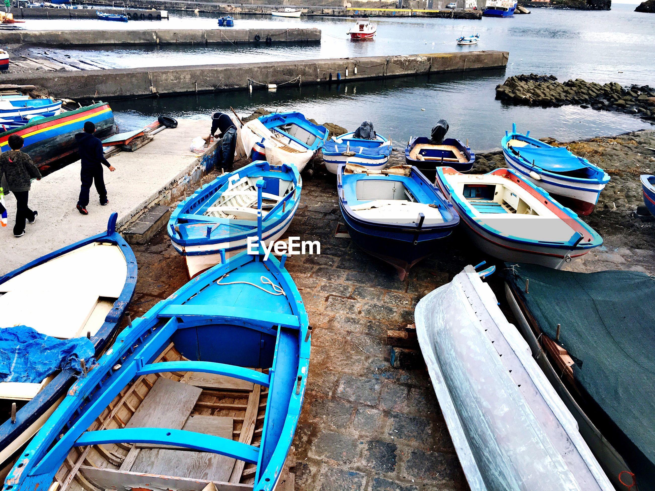 Boats moored at seaside