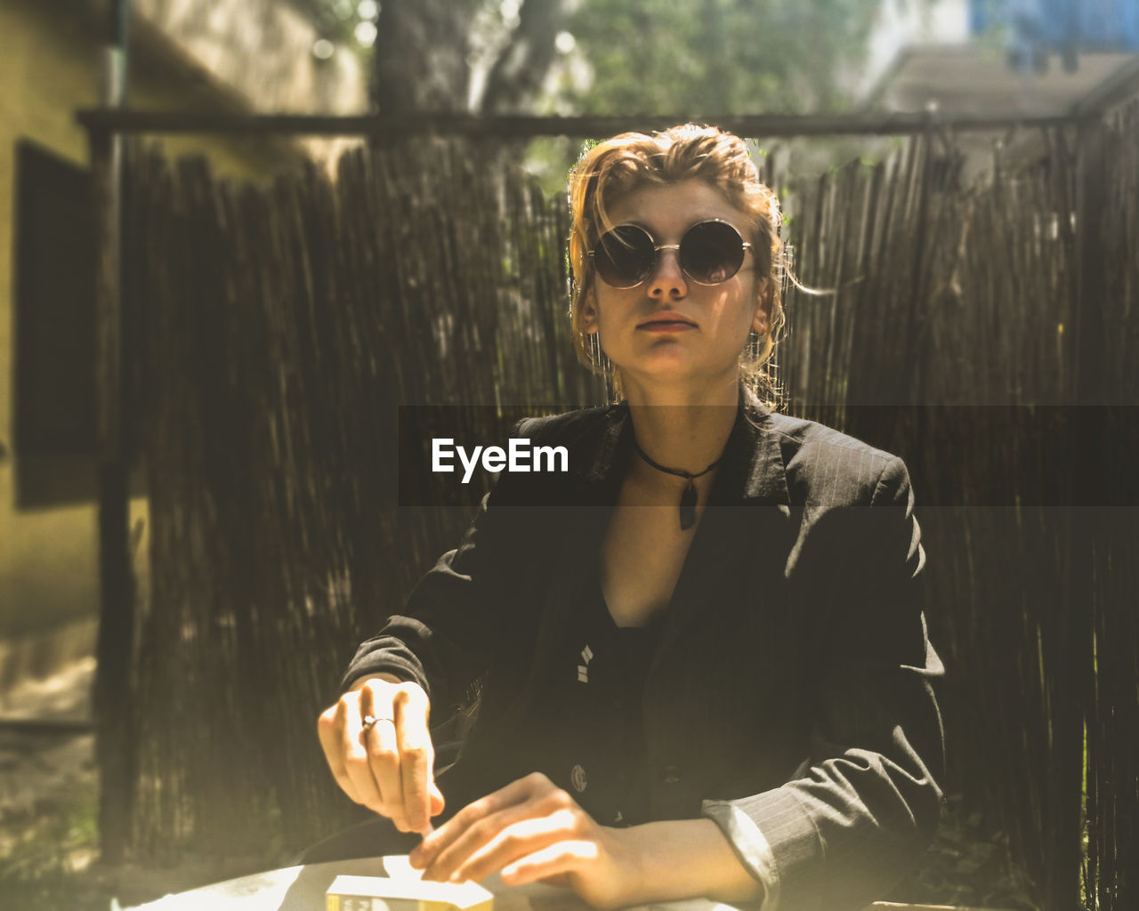 Portrait of young woman wearing sunglasses during sunny day