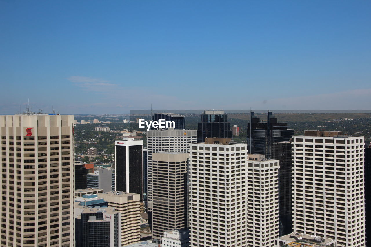 MODERN BUILDINGS AGAINST CLEAR BLUE SKY IN CITY