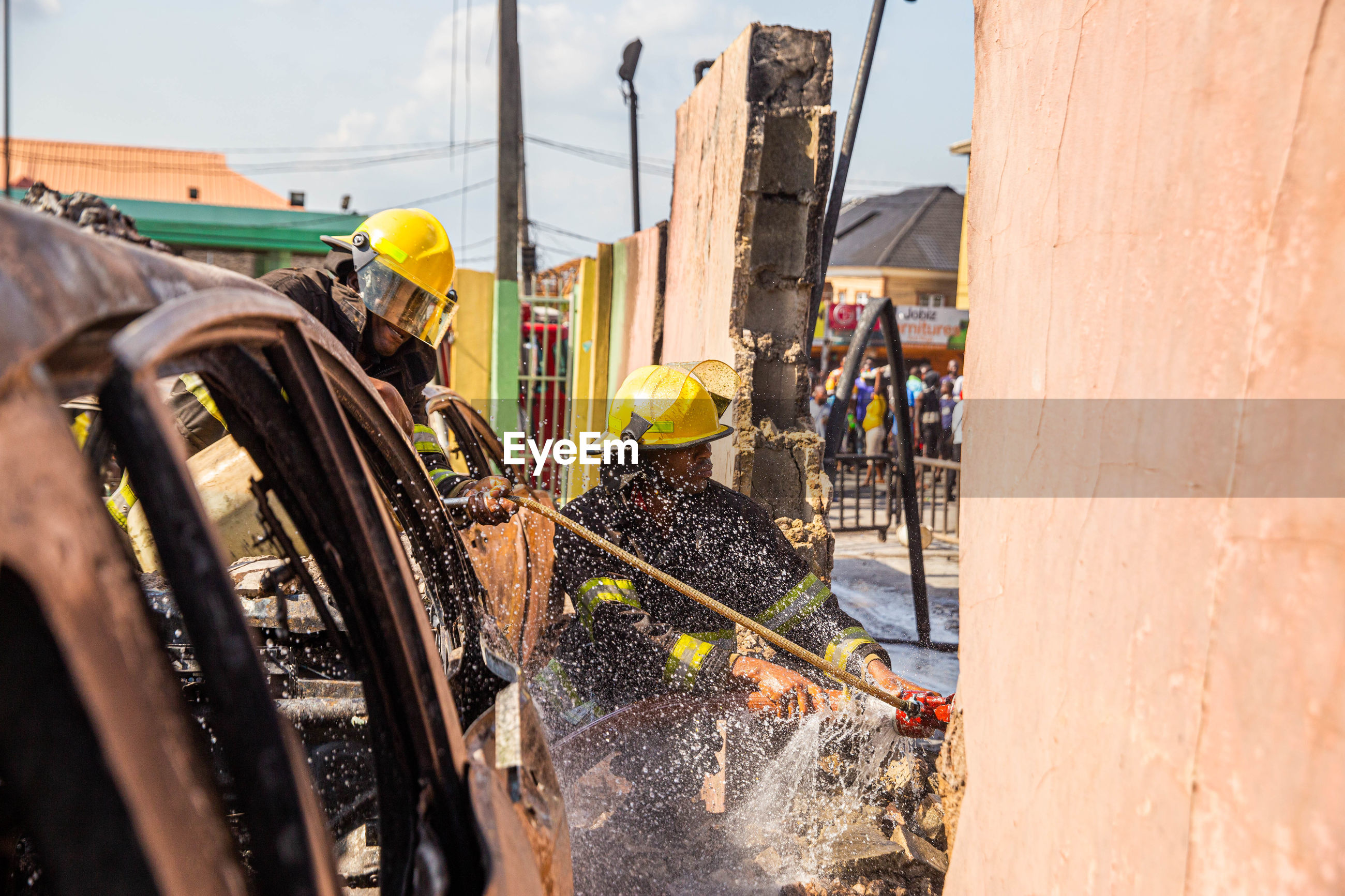 Firefighter watering on wall