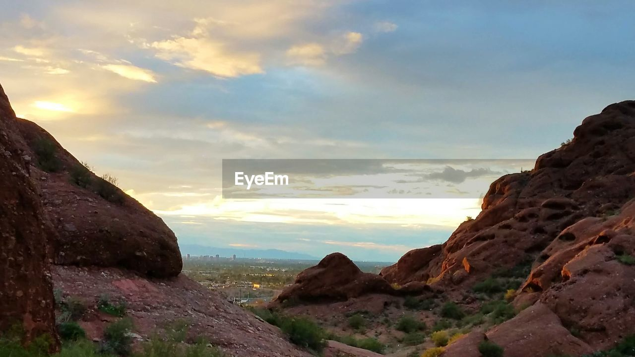 sky, cloud - sky, rock - object, sunset, nature, scenics, tranquil scene, tranquility, mountain, beauty in nature, outdoors, no people, landscape, day