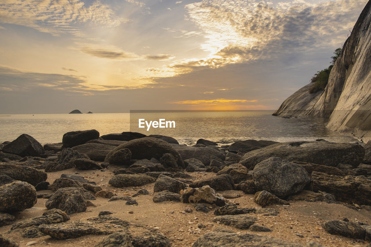 sky, sunset, water, sea, rock, beauty in nature, scenics - nature, beach, horizon over water, solid, land, rock - object, cloud - sky, tranquility, horizon, tranquil scene, nature, idyllic, no people, outdoors, rocky coastline