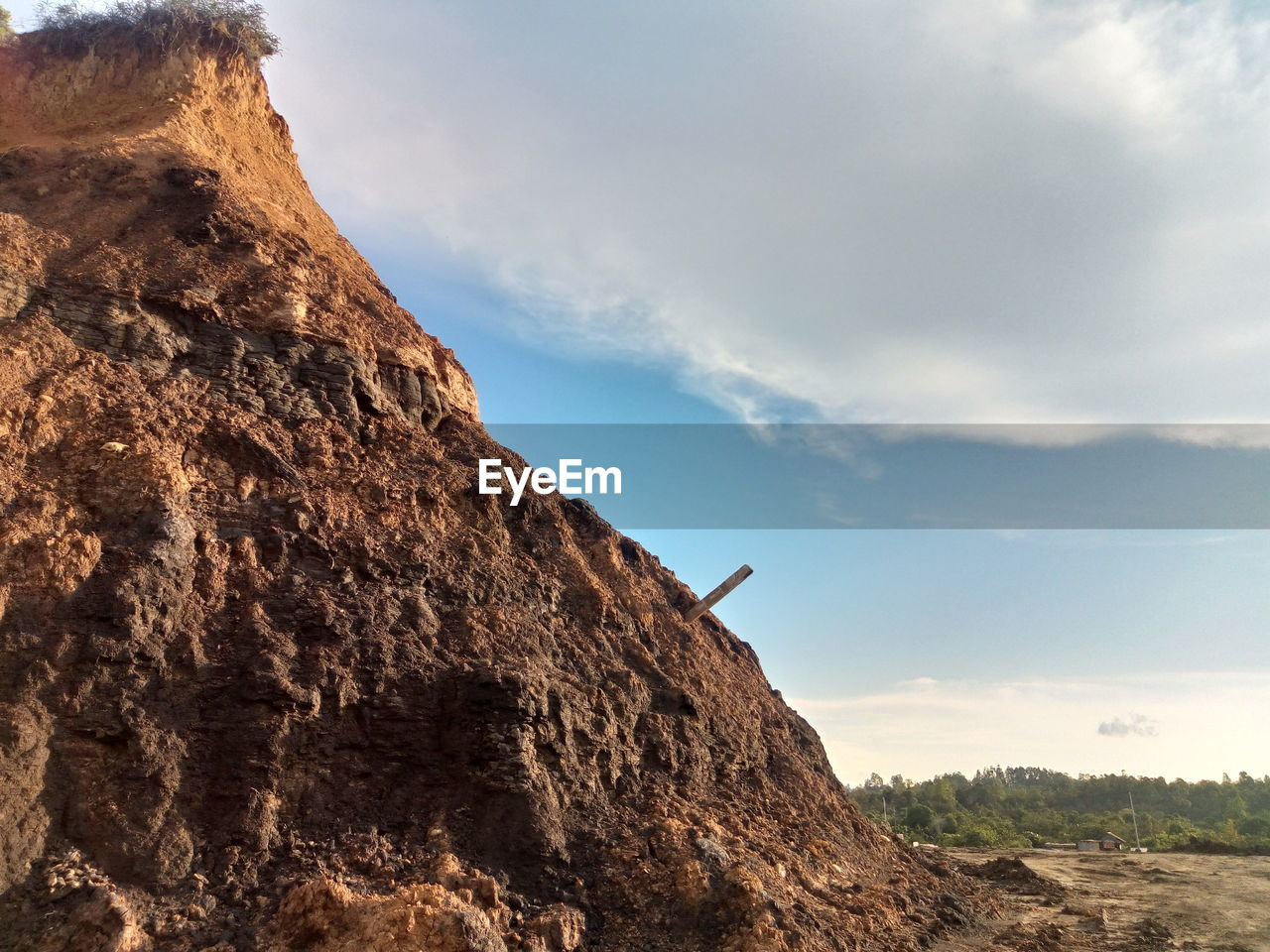 rock, sky, rock - object, solid, rock formation, mountain, beauty in nature, cloud - sky, day, nature, scenics - nature, low angle view, mountain range, tranquil scene, tranquility, land, geology, non-urban scene, cliff, physical geography, formation, outdoors, no people, eroded, mountain peak