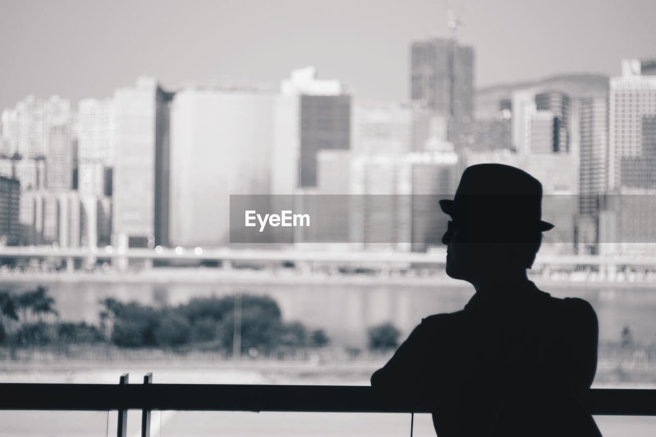Man In Cruise Ship Looking At Cityscape