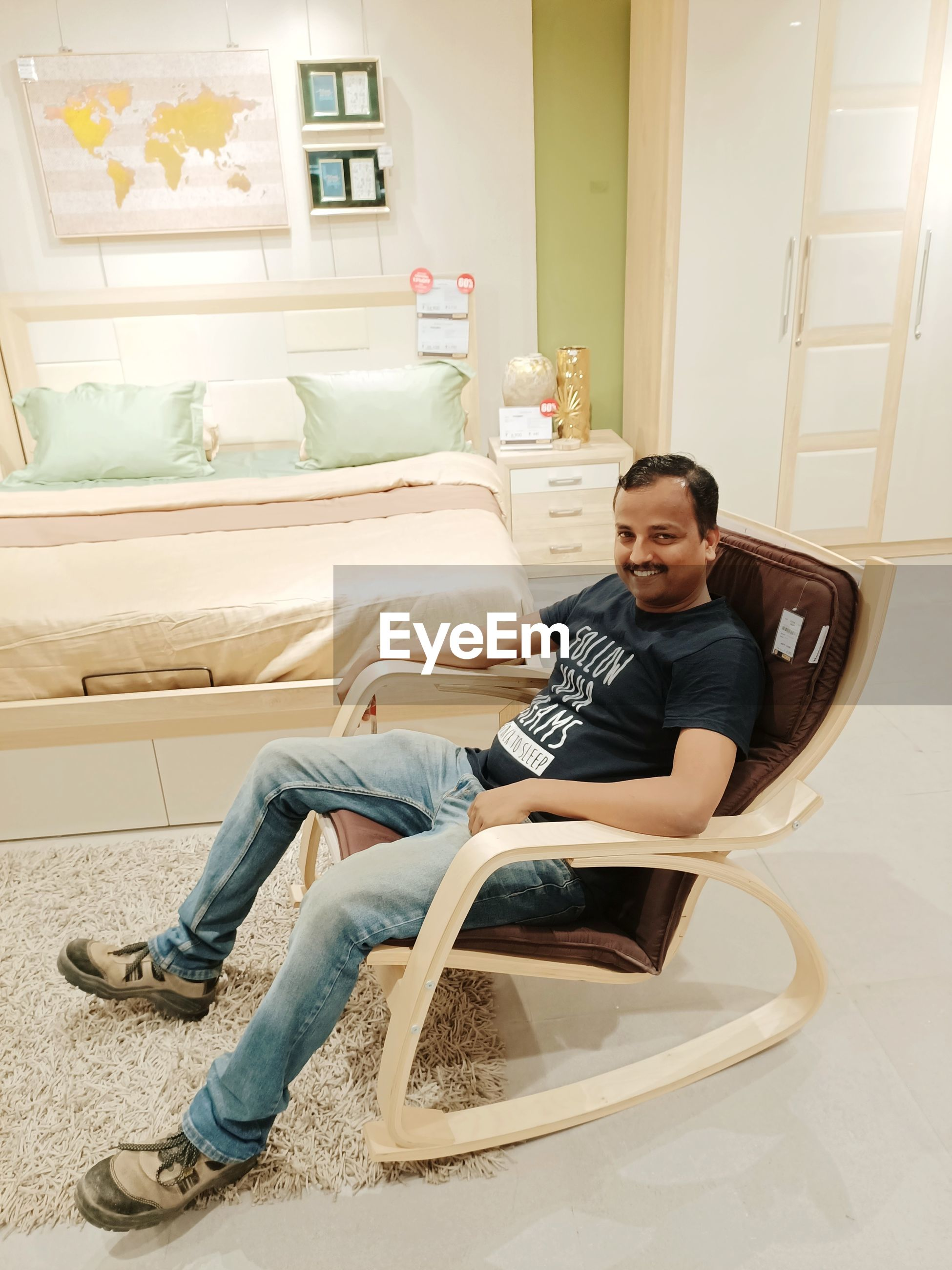 Portrait of smiling man sitting on rocking chair