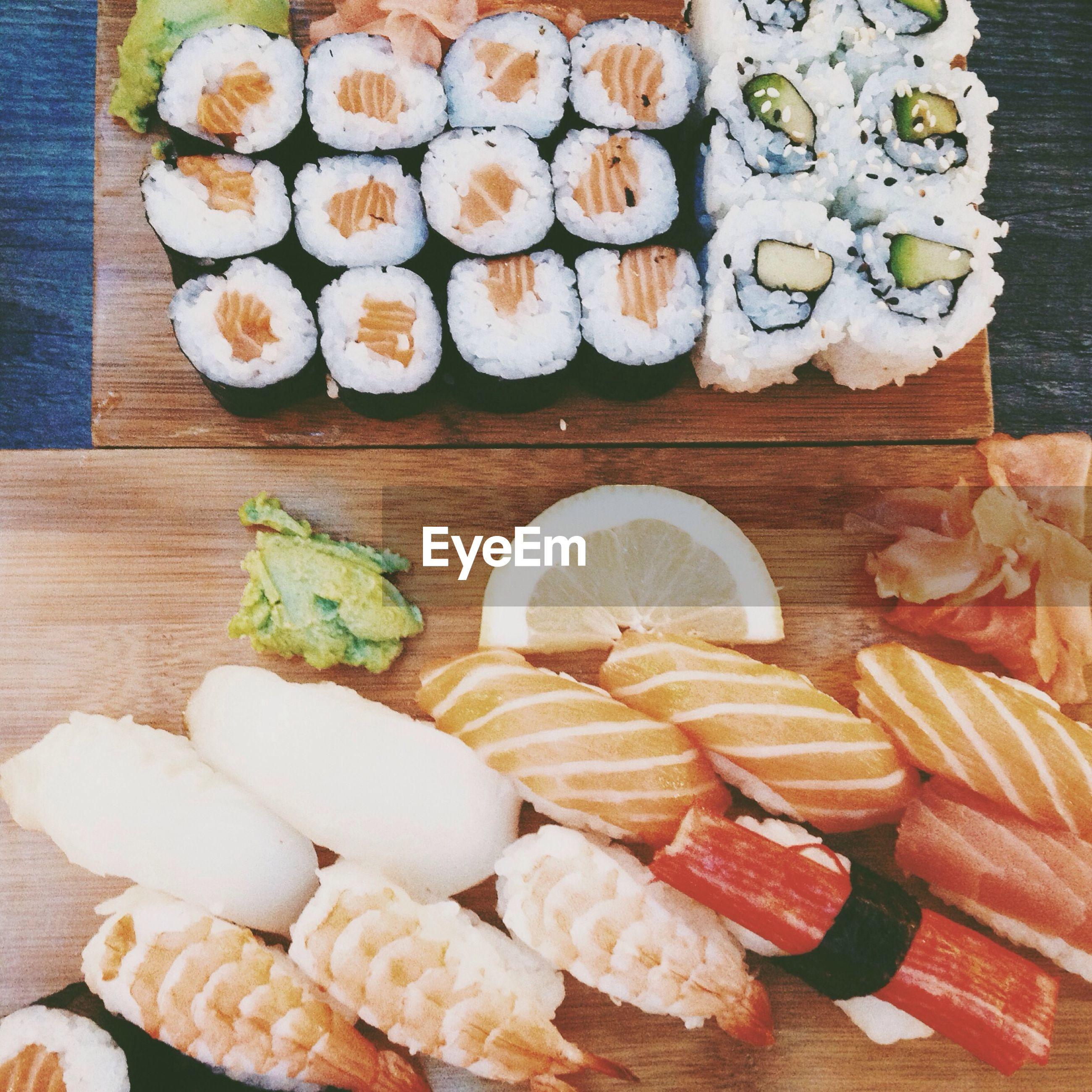 Various sushi on table