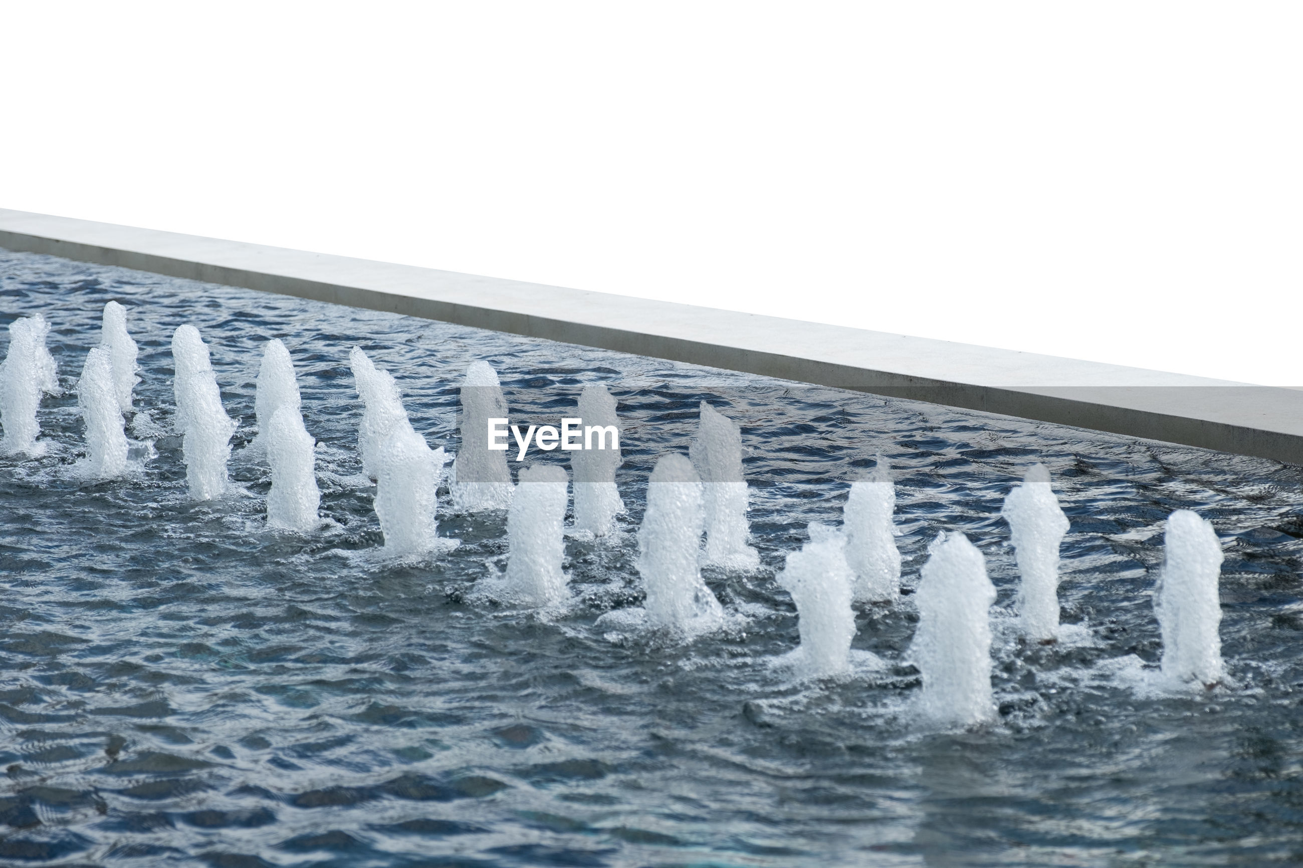 WATER SPLASHING IN ROW AGAINST CLEAR SKY