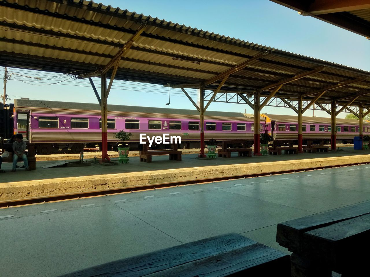 railroad station platform, rail transportation, architecture, railroad station, public transportation, built structure, mode of transportation, transportation, reflection, incidental people, train, travel, nature, day, track, train - vehicle, indoors, railroad track, waiting, architectural column, swimming pool, station, ceiling