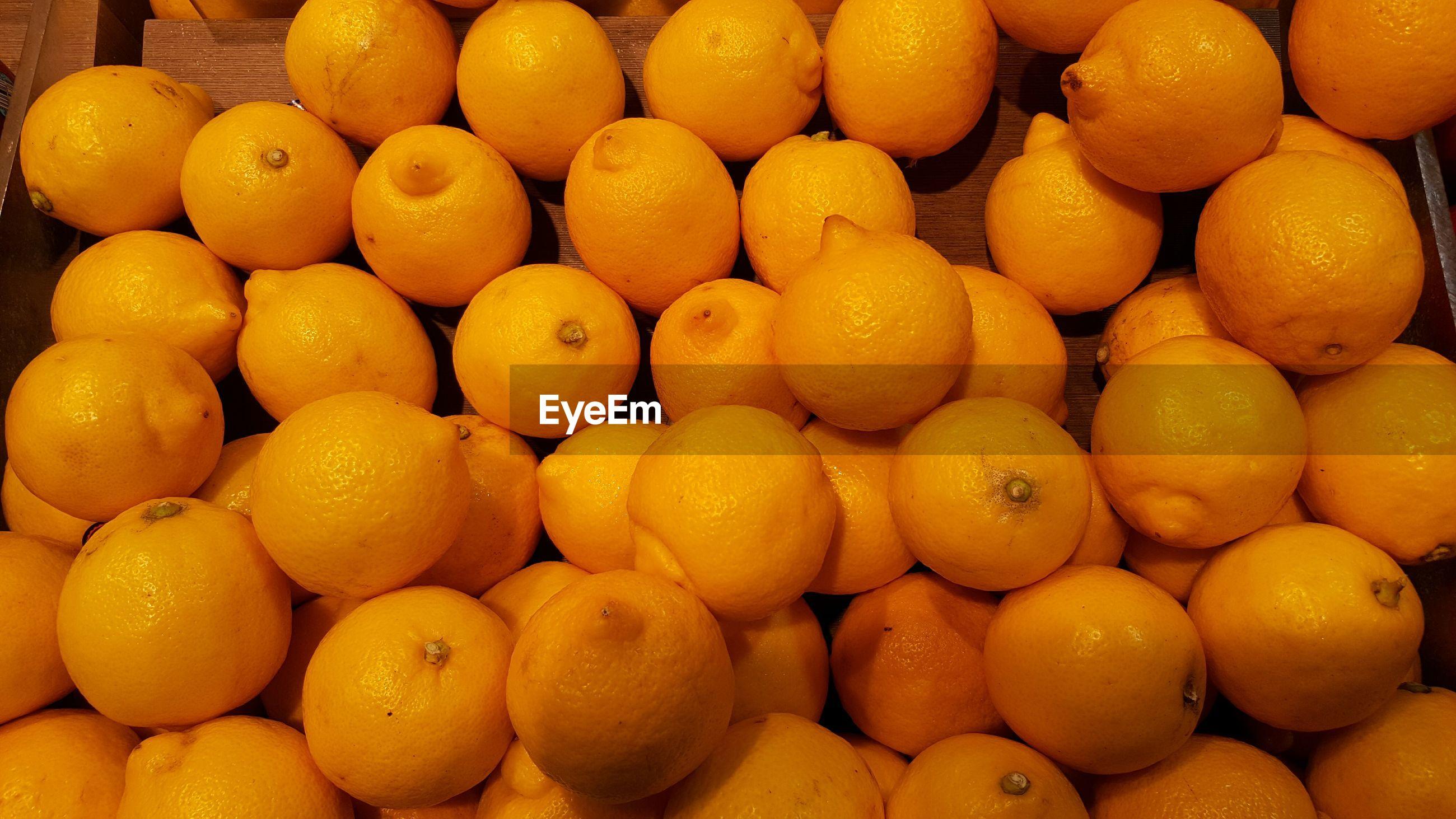 Full frame shot of lemons at market