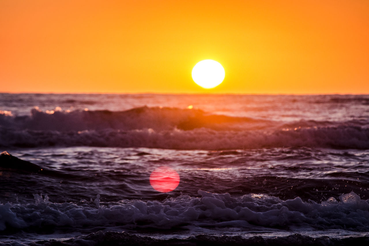 sunset, sun, beauty in nature, sea, nature, orange color, scenics, sky, tranquility, horizon over water, water, tranquil scene, moon, idyllic, sunlight, no people, outdoors, wave, clear sky, red, astronomy, day
