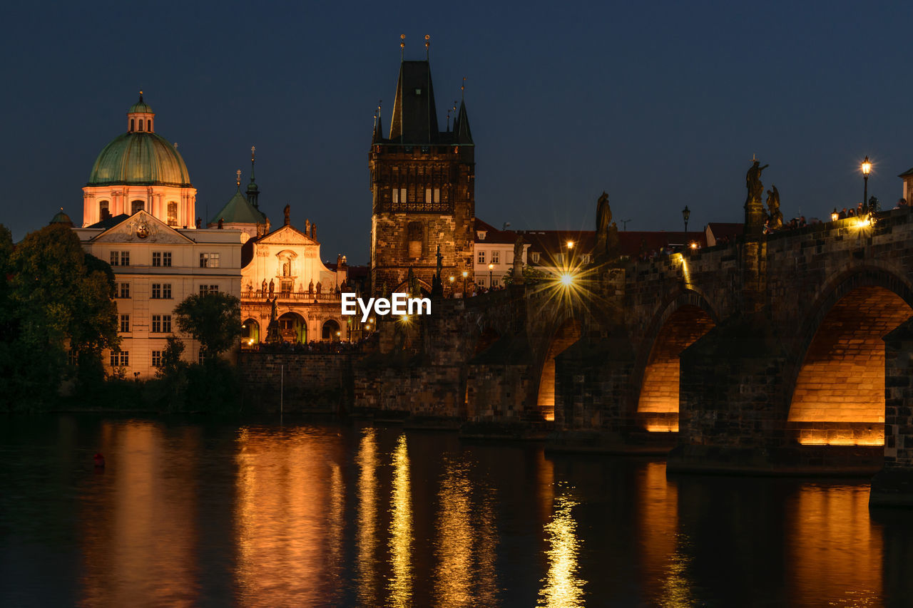 architecture, building exterior, built structure, water, illuminated, night, sky, reflection, river, history, the past, building, waterfront, travel destinations, religion, nature, no people, tourism, bridge, bridge - man made structure
