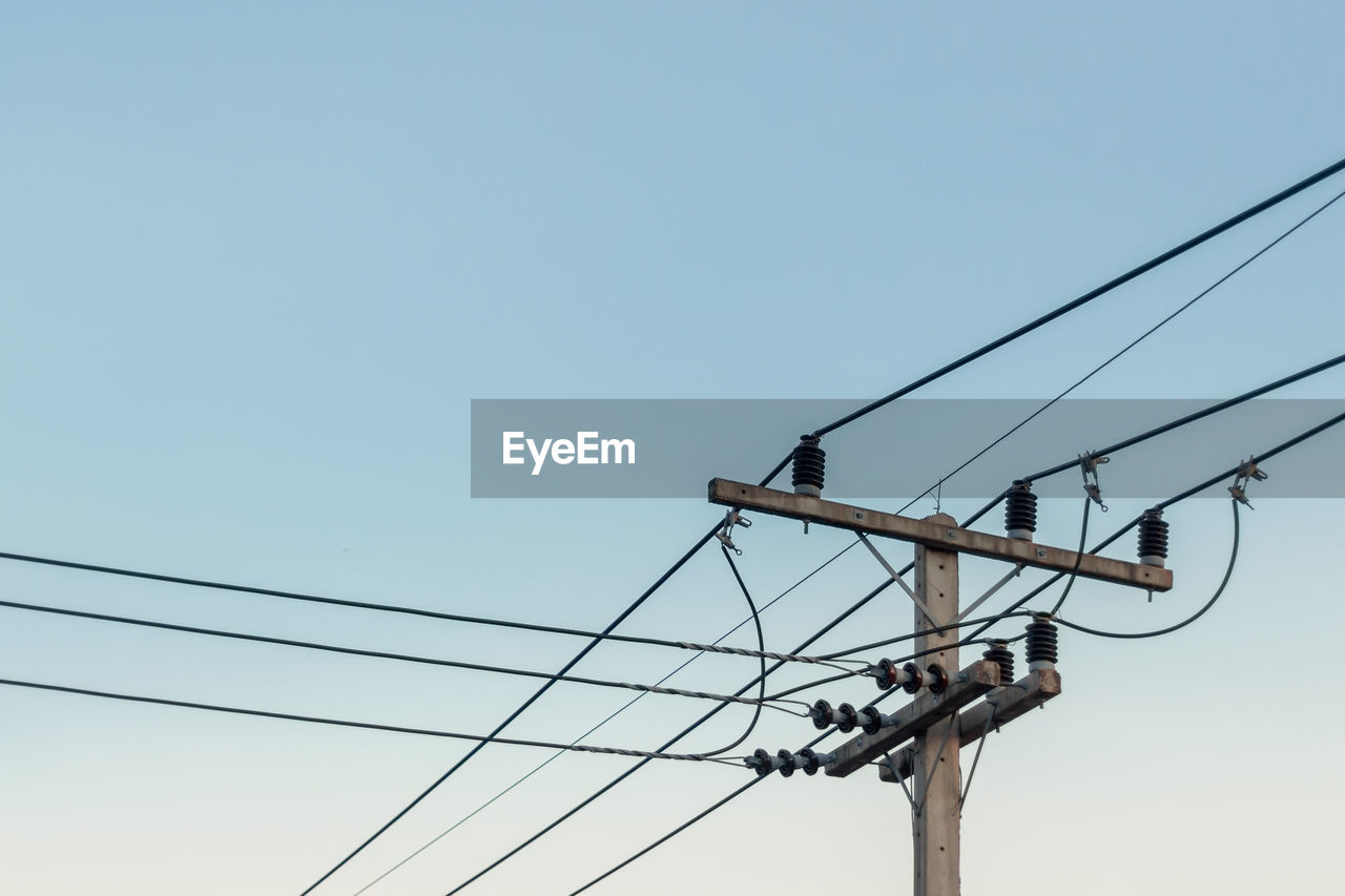cable, electricity, sky, power line, low angle view, connection, power supply, technology, electricity pylon, fuel and power generation, blue, animals in the wild, nature, clear sky, bird, animal wildlife, animal themes, no people, animal, day, outdoors, complexity, telephone line, flock of birds, electrical equipment