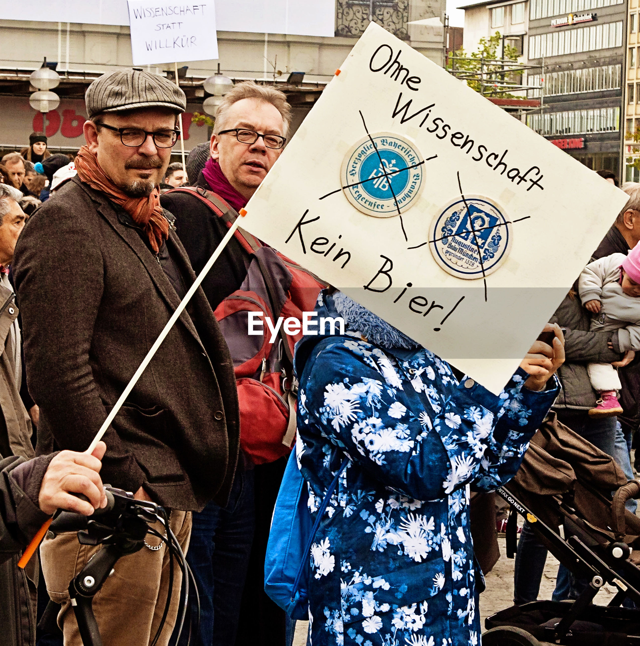 text, jacket, communication, placard, men, two people, politics, real people, law, outdoors, day, politics and government, adult, volunteer, people, adults only