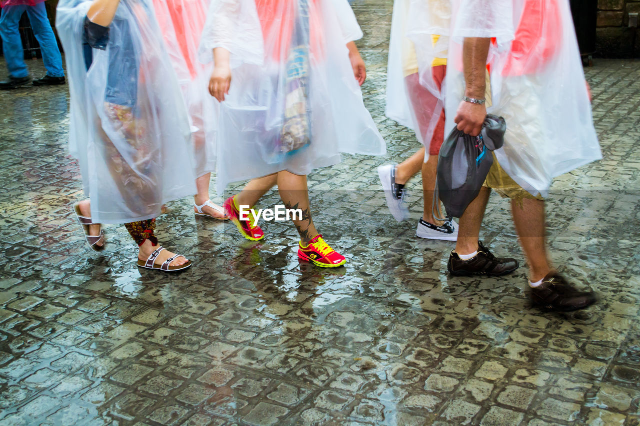 human leg, low section, real people, women, celebration, togetherness, wedding, walking, men, human body part, dancing, tradition, day, lifestyles, bride, outdoors, large group of people, wedding dress, groom, bridegroom, adult, people