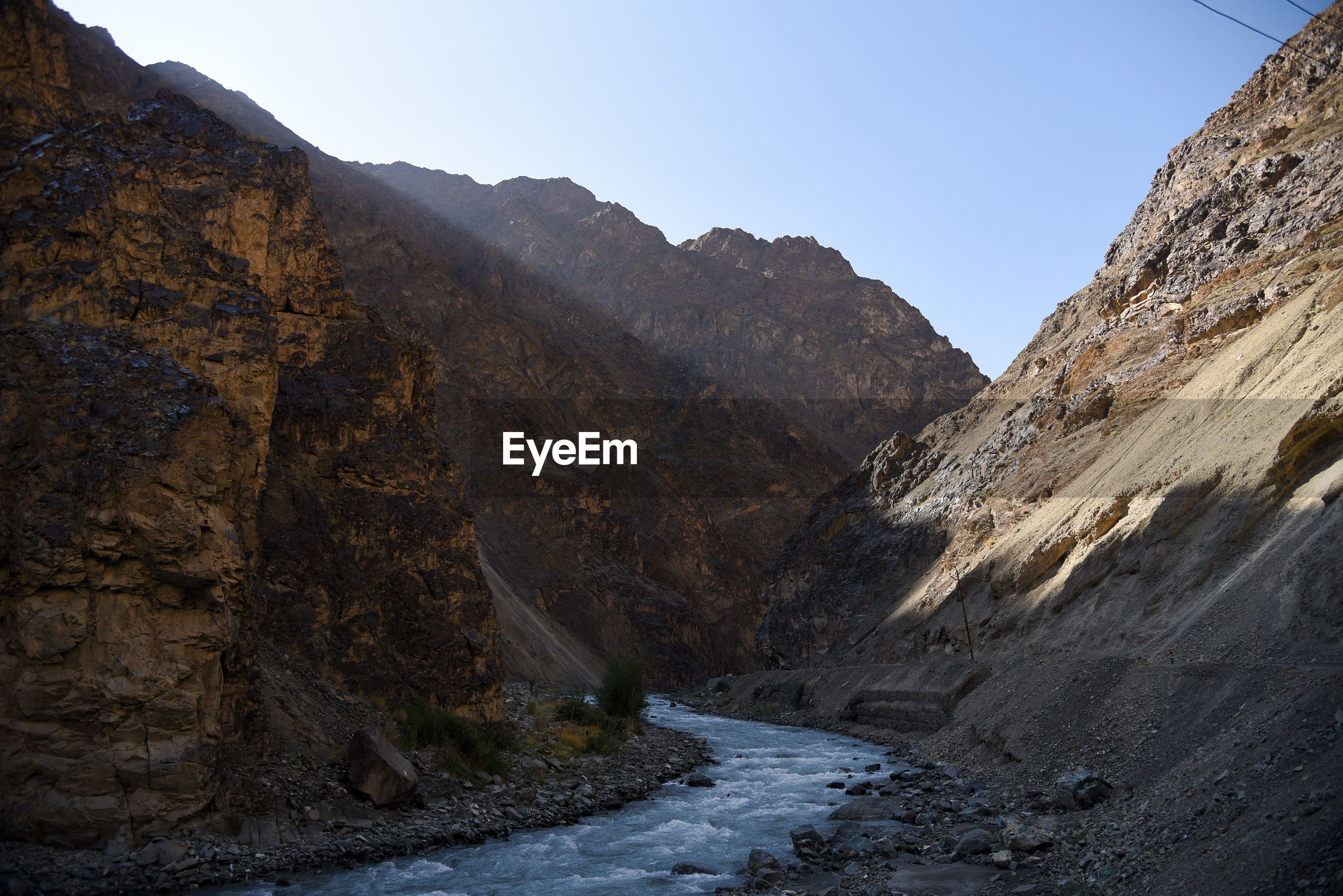 River sindh flow in between mountain next to highway leading to leh-ladakh on 29 june 2020.