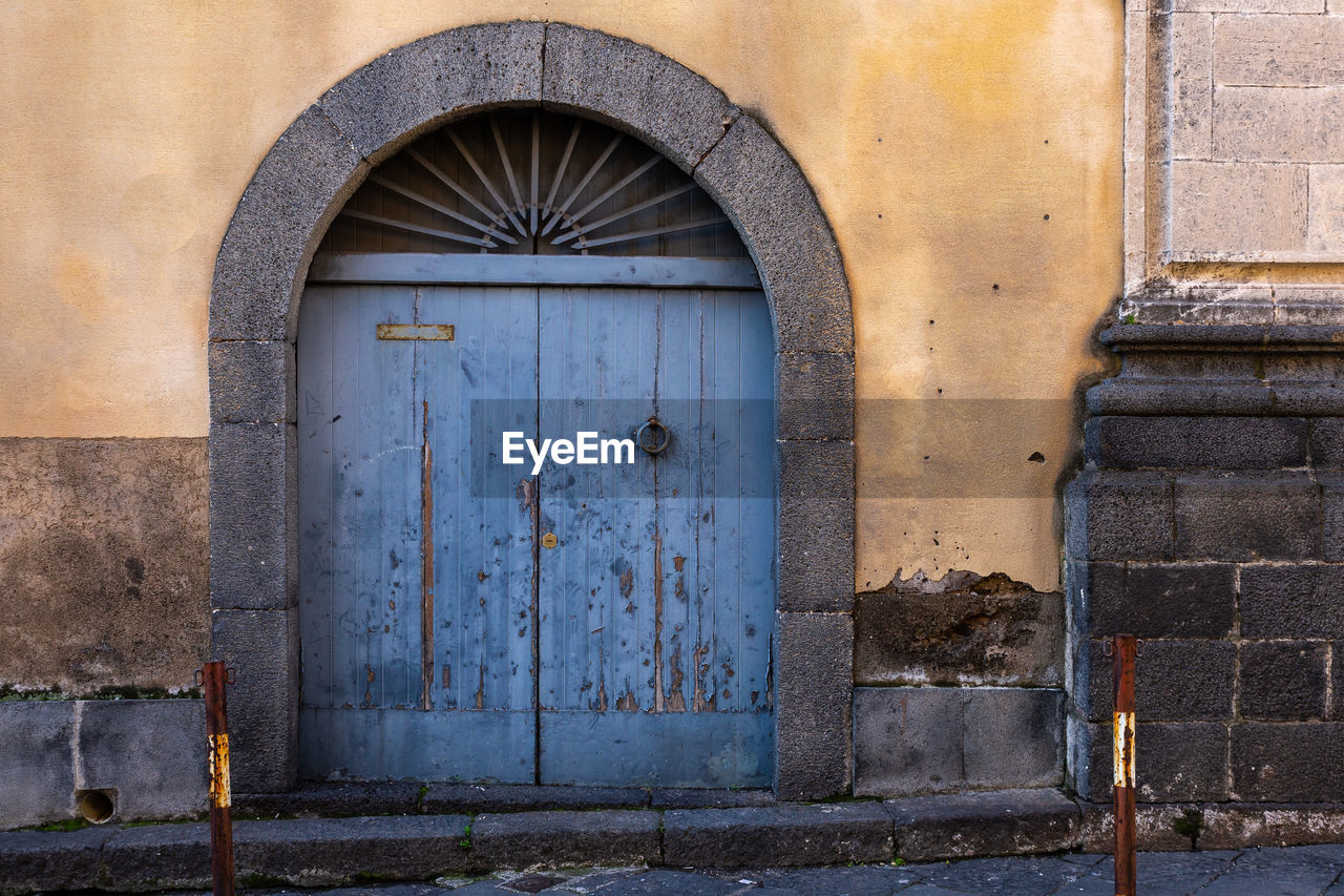 architecture, built structure, door, entrance, building exterior, closed, building, security, arch, no people, wall - building feature, day, safety, old, protection, house, wood - material, outdoors, wall, weathered, arched