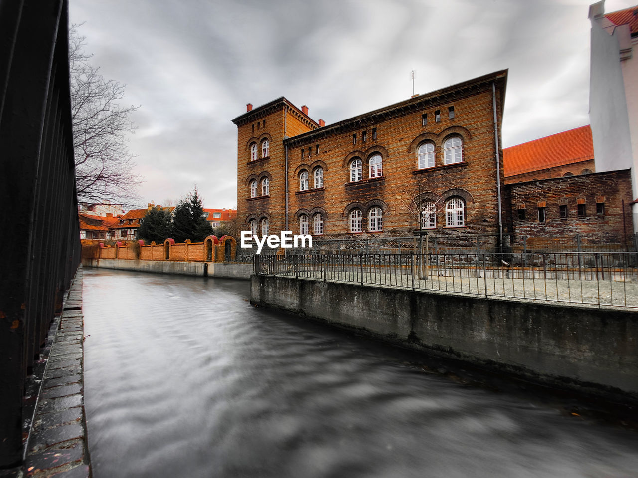 CANAL BY BUILDING AGAINST SKY