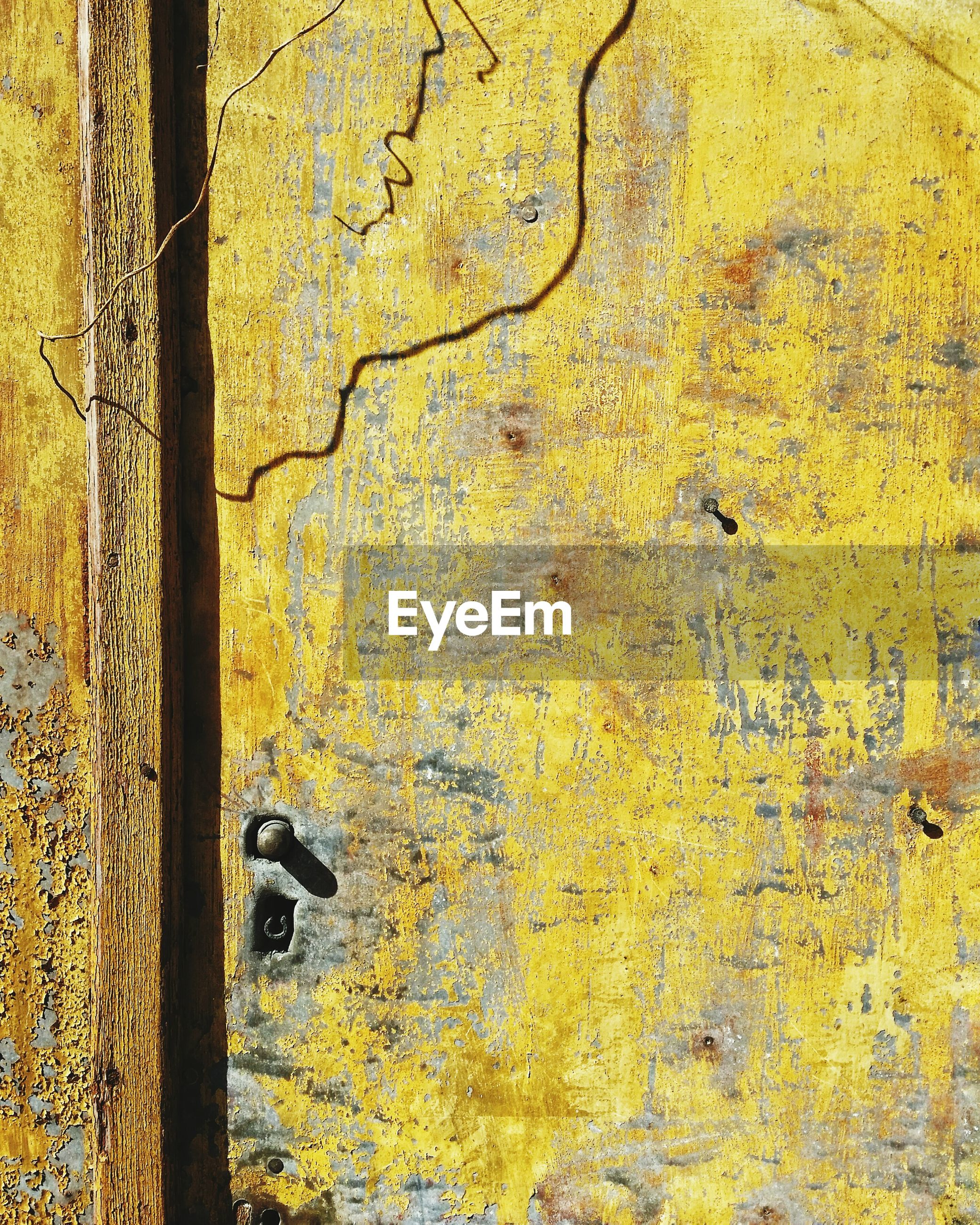 yellow, old, no people, weathered, close-up, metal, wood - material, full frame, door, safety, day, entrance, protection, textured, backgrounds, outdoors, security, pattern, wall - building feature, nature, latch