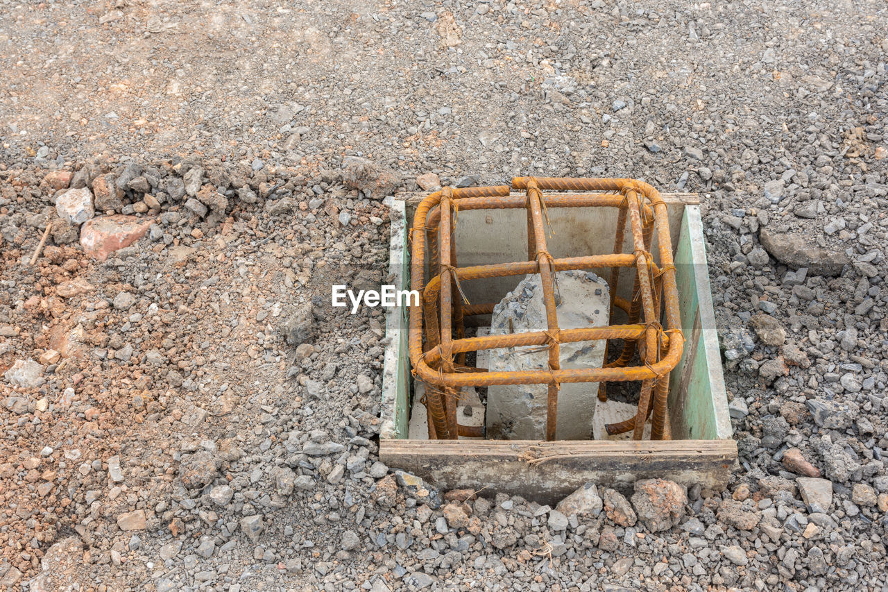 no people, day, high angle view, solid, outdoors, single object, nature, rock - object, wall - building feature, rock, road, land, old, close-up, architecture, transportation, box, container, box - container, animal themes, concrete