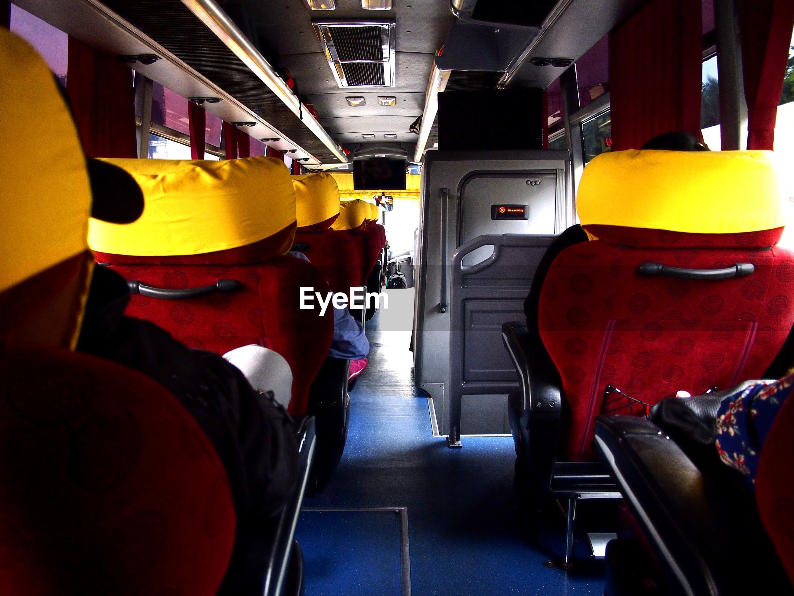 Rear view of people seating in bus