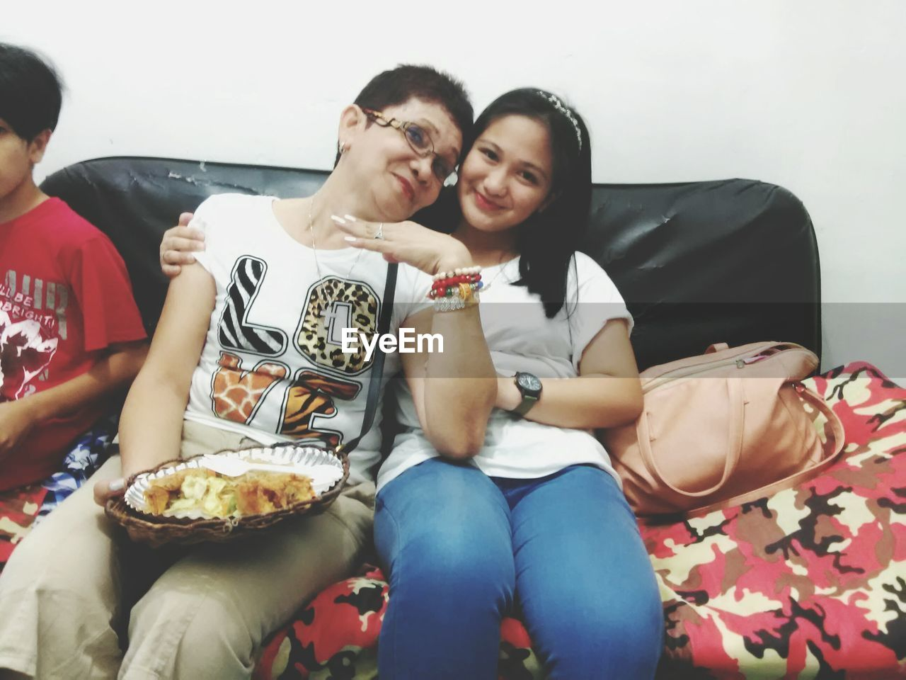 sitting, sofa, food and drink, togetherness, leisure activity, real people, young women, young adult, food, indoors, lifestyles, friendship, day