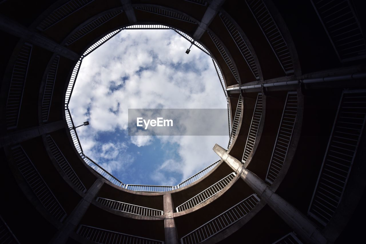 architecture, built structure, low angle view, cloud - sky, sky, directly below, no people, indoors, nature, day, building, shape, geometric shape, circle, city, sunlight, pattern, travel destinations, skylight, ceiling
