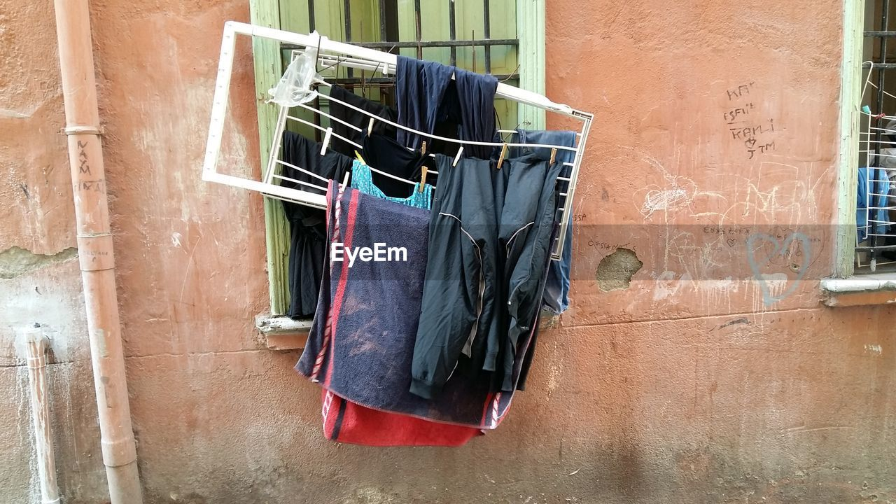 hanging, clothesline, drying, clothing, architecture, house, building exterior, no people, built structure, laundry, day, cloth, coathanger, outdoors