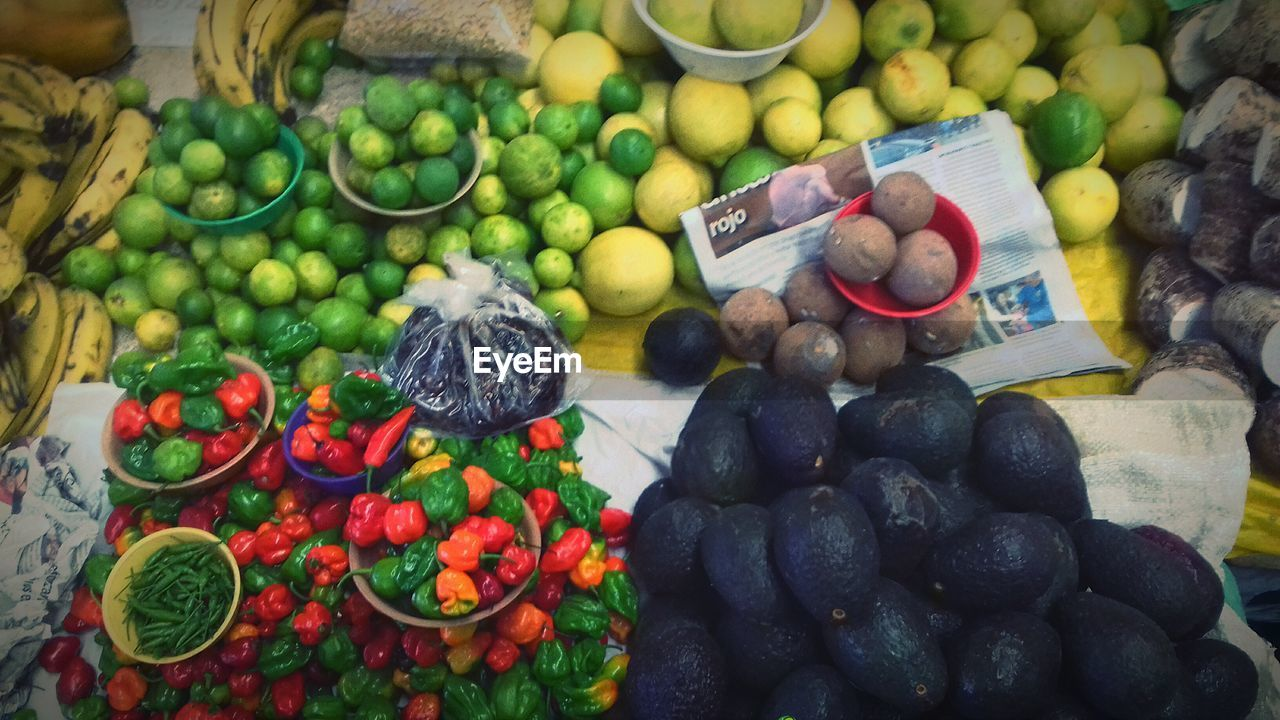 food, fruit, healthy eating, large group of objects, food and drink, freshness, vegetable, abundance, still life, variation, grape, high angle view, for sale, tomato, market stall, no people, basket, retail, market, day, choice, price tag, indoors, close-up, black olive