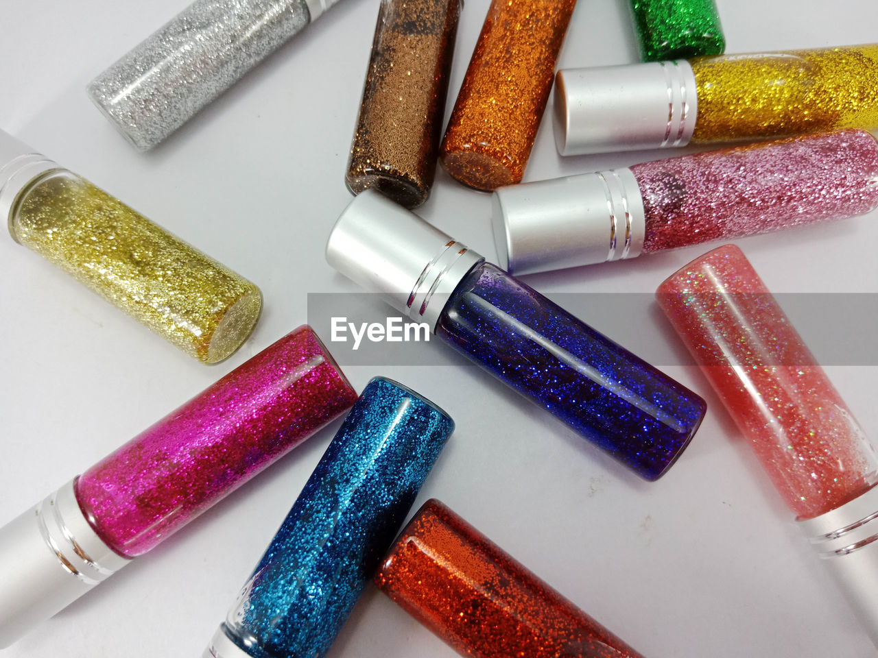 Close-up of glitters over white background