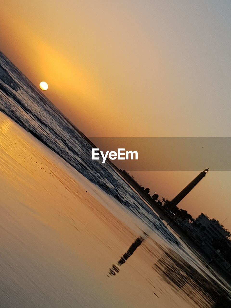 sky, sunset, sea, orange color, water, beauty in nature, scenics - nature, horizon over water, nature, horizon, tilt, land, no people, beach, architecture, tranquility, built structure, sun, tranquil scene, outdoors