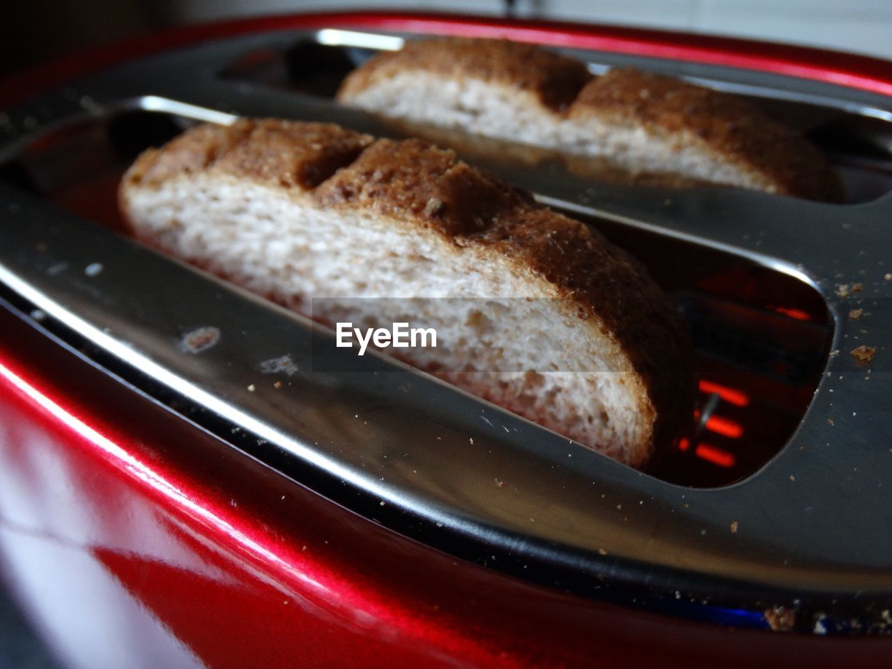 Close-Up Of Breads In Toaster