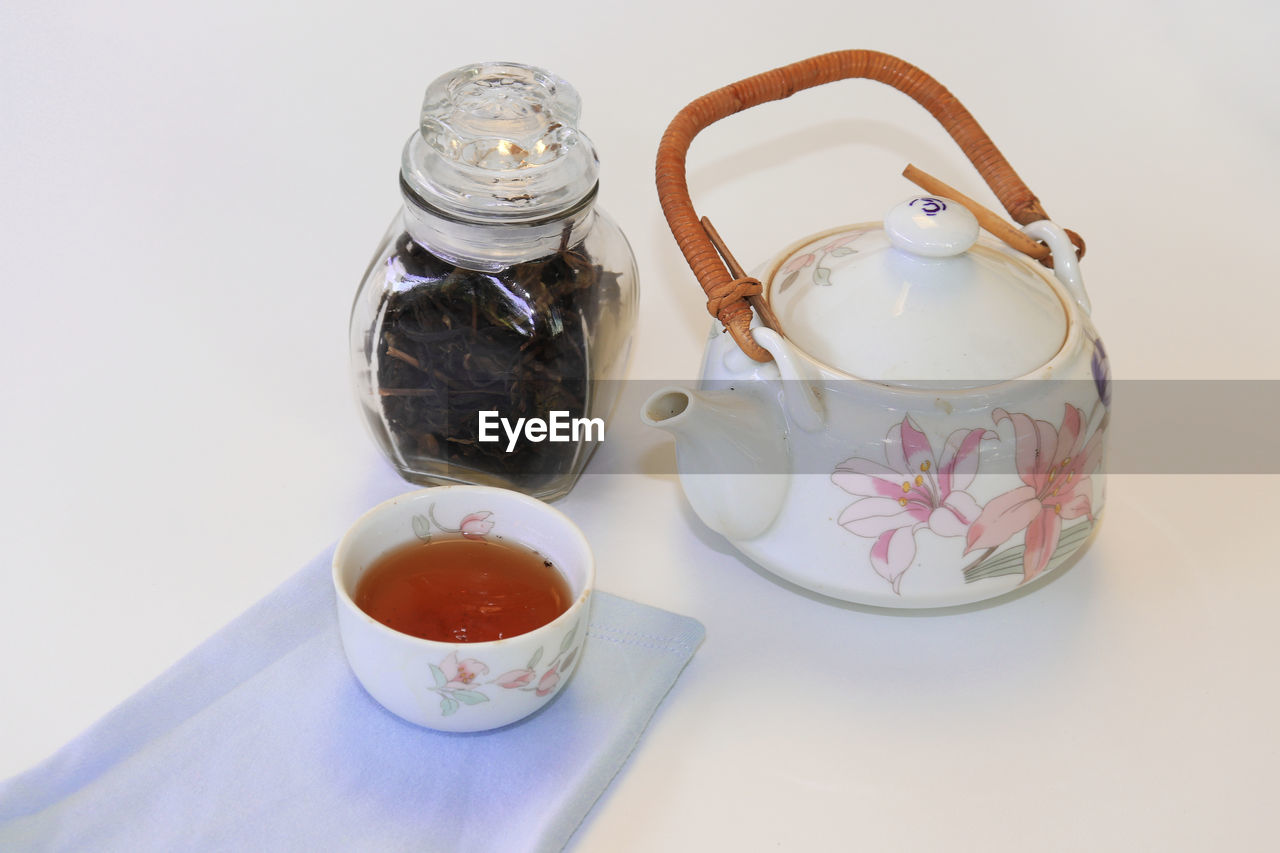 food and drink, still life, indoors, teapot, refreshment, container, drink, food, high angle view, cup, close-up, tea, no people, table, tea - hot drink, jar, freshness, hot drink, mug, glass - material, tea cup, crockery
